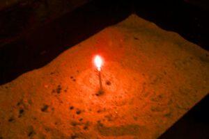 Kerze im Sand